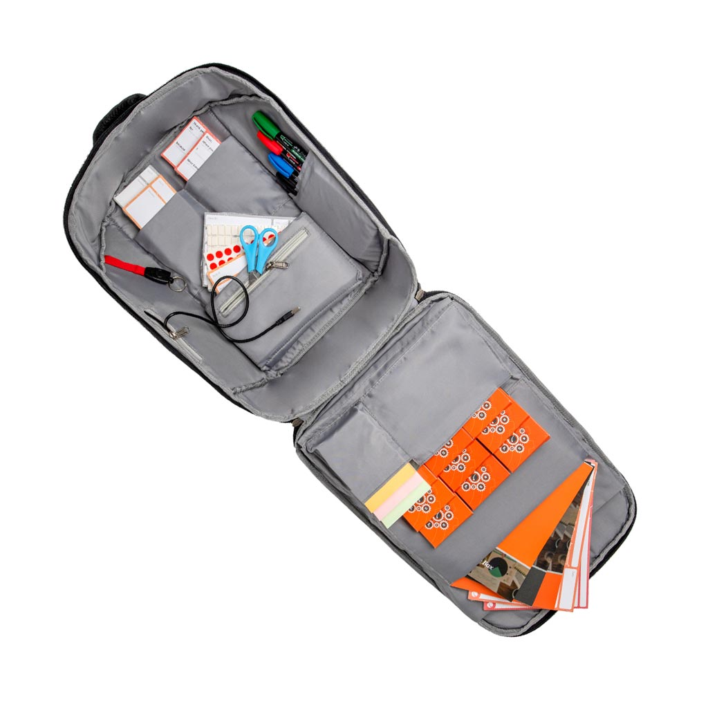 The Agile Box backpack open with content